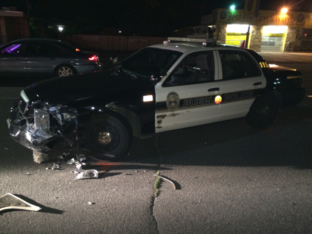 An armed robbery suspect crashed into this Pueblo police car during a chase Sunday. _ Pueblo Police Department_193220