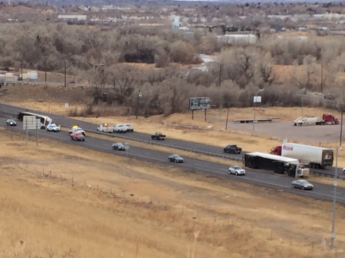 Two overturned semis on Interstate 25 at South Academy Boulevard Monday morning. _ Mike Duran - FOX21 News_214849