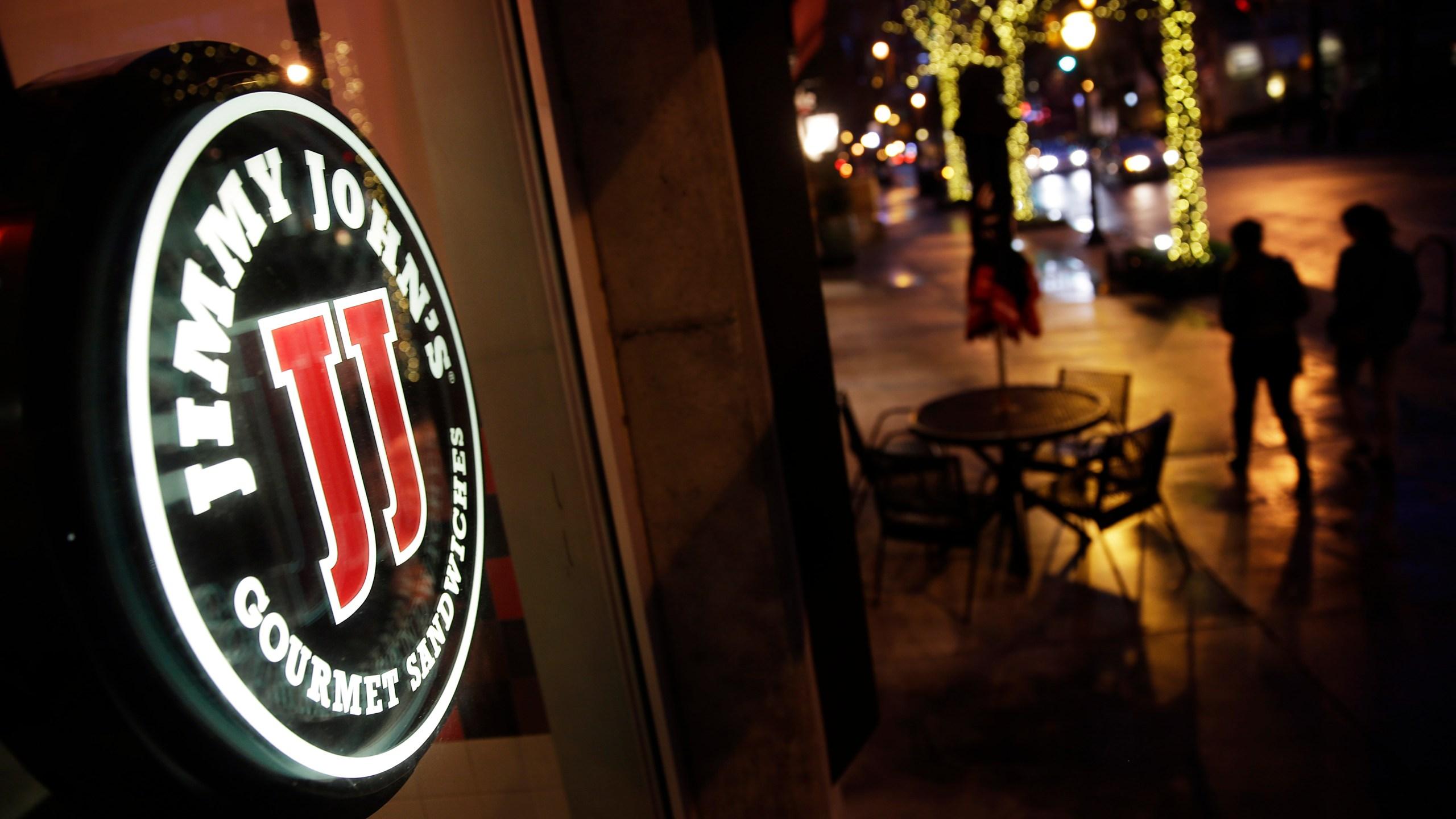 Pedestrians pass by a Jimmy John's sandwich shop, Friday, Jan. 2, 2015, in Atlanta. (AP Photo_David Goldman)_257209