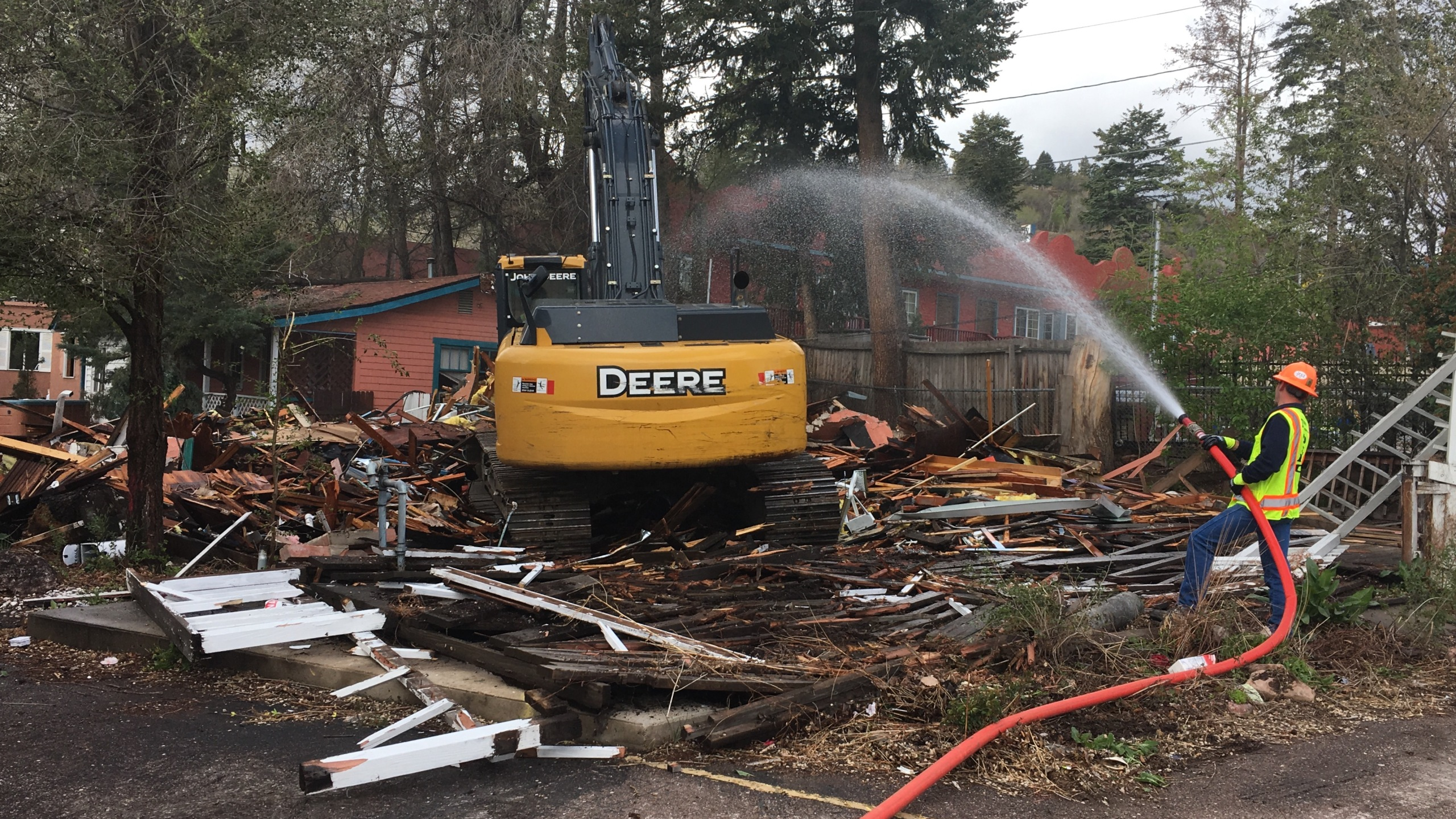Crews begin demolishing the former Sunflower Motel on West Colorado Avenue Wednesday morning. _ Mike Duran - FOX21 News_258150