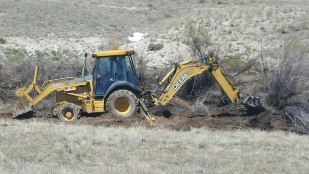 Pueblo police and the Colorado Bureau of Investigation search an open area on Pueblo's southwest side. The investigators are looking for clues _257290
