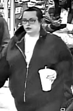 Surveillance image shows the woman accused of using a stolen credit card at a Colorado Springs business in February. _ Colorado Springs Police _259091