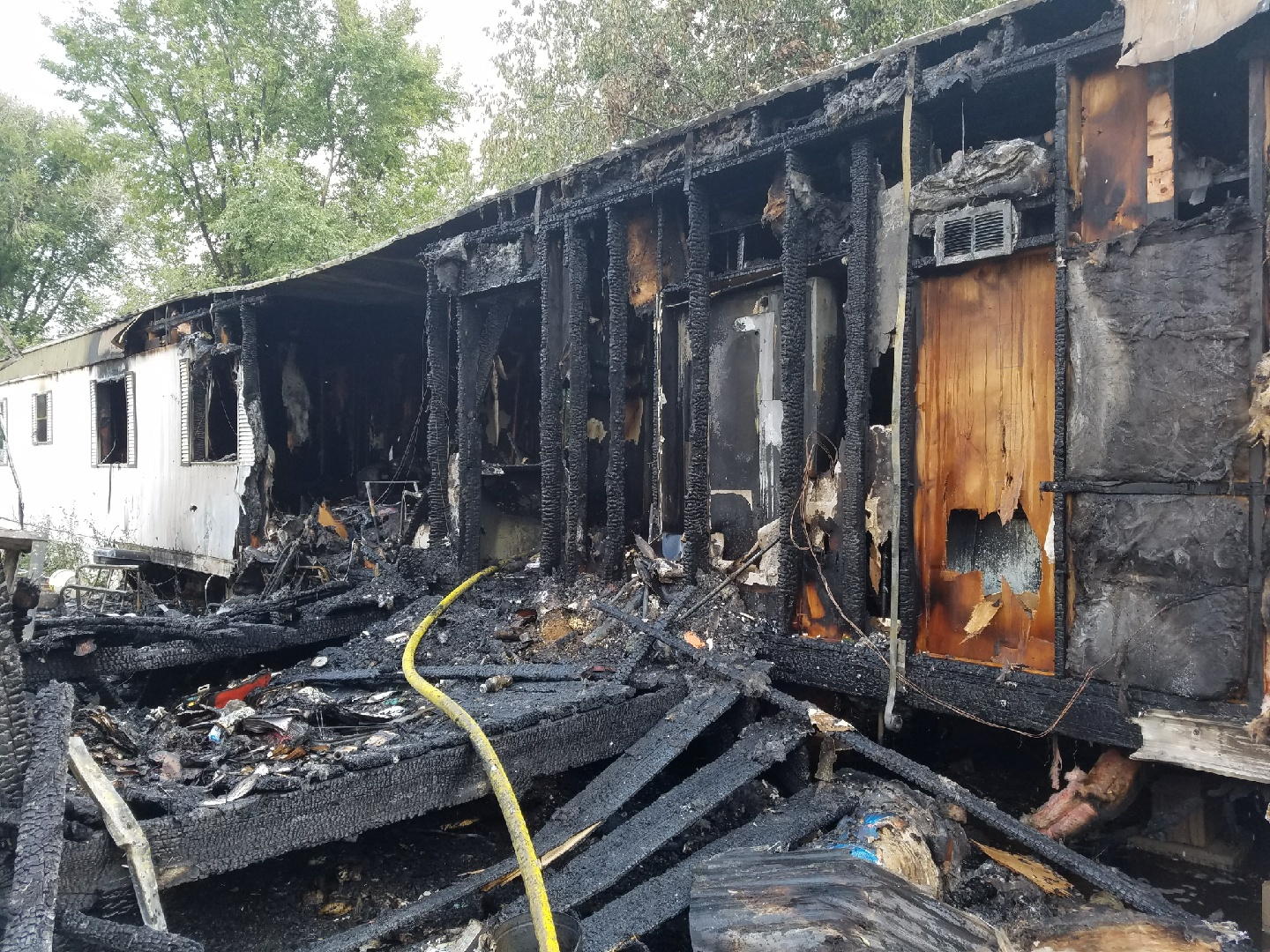 Two firefighters were injured and several pets were killed in a fire in a Florence mobile home park Friday afternoon. _ Florence Police Departm_311055