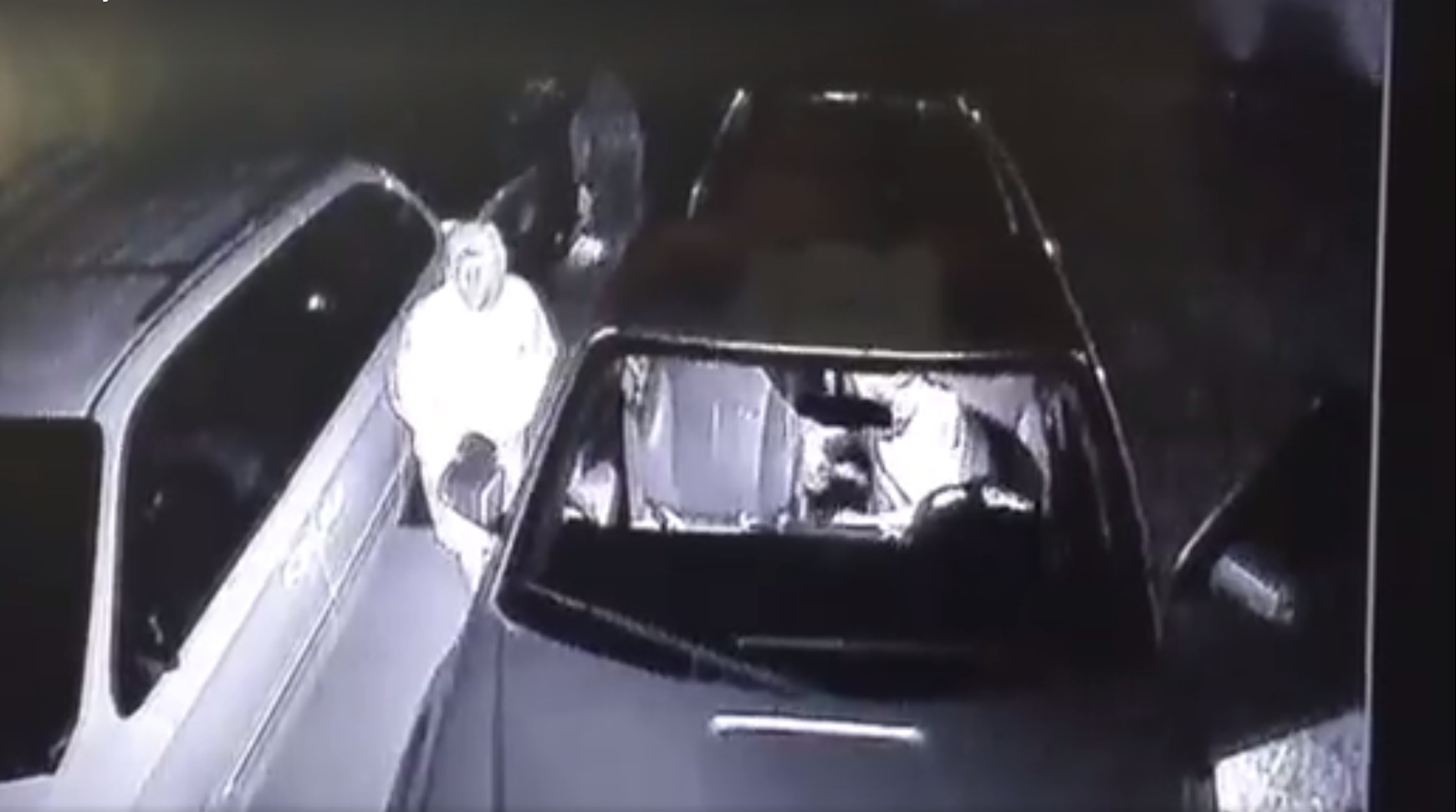 Image from surveillance video shows two suspects breaking into a car in Pueblo West Saturday morning. _ Pueblo County Sheriff's Office_311059