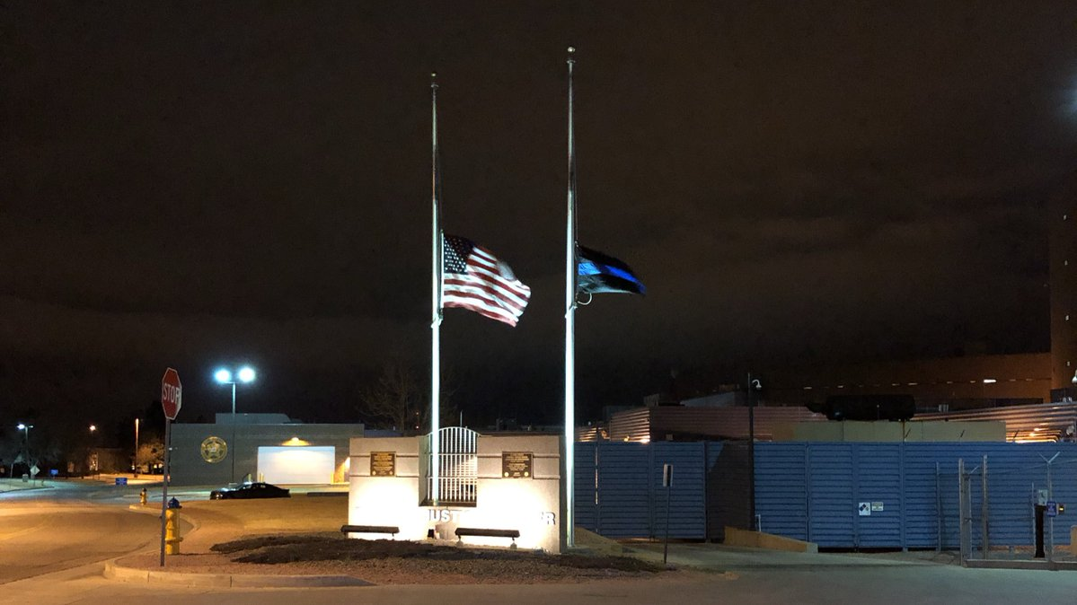 Flags are lowered to half-staff outside the El Paso County Coroner's Office Monday night in honor of Detective Micah Flick. Samantha Marks - FOX21 N