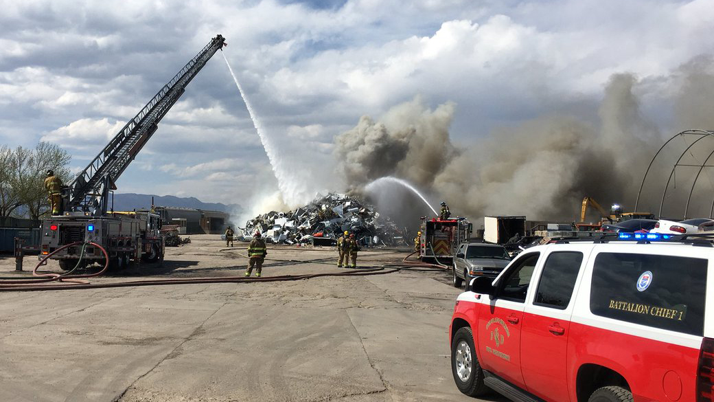 Firefighters fight a scrap pile fire at EVRAZ Recycling in southern Colorado Springs Monday afternoon. Colorado Springs Fire Department