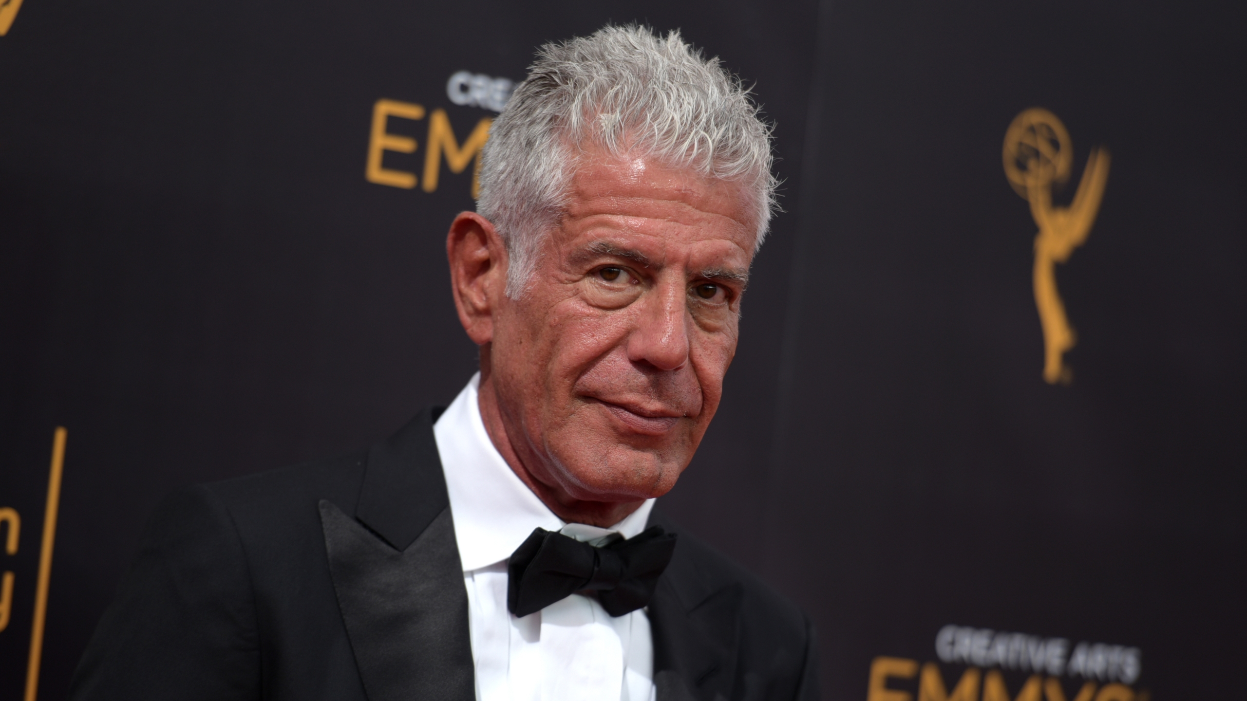 Anthony Bourdain arrives at night two of the Creative Arts Emmy Awards at the Microsoft Theater on Sunday, Sept. 11, 2016, in Los Angeles. Photo by R