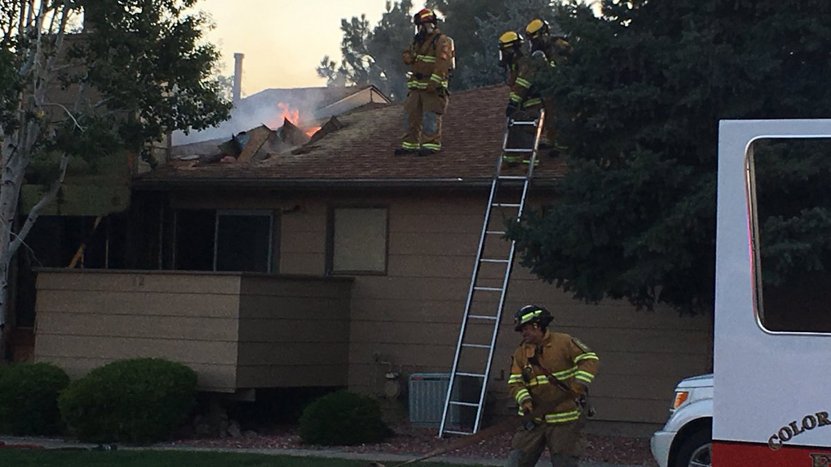 Firefighters fight a fire in a fourplex on Stovel Circle in eastern Colorado Springs Saturday. Colorado Springs Fire Department