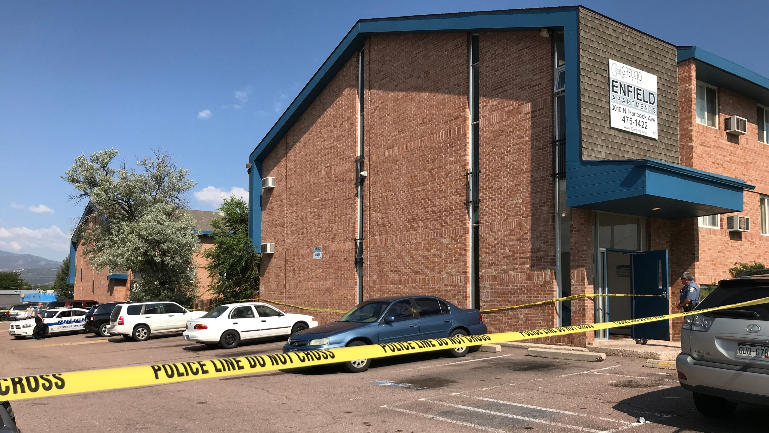 Police investigating a suspicious death at the Enfield Apartments on Hancock Avenue Friday morning. Shawn Shanle - FOX21 News