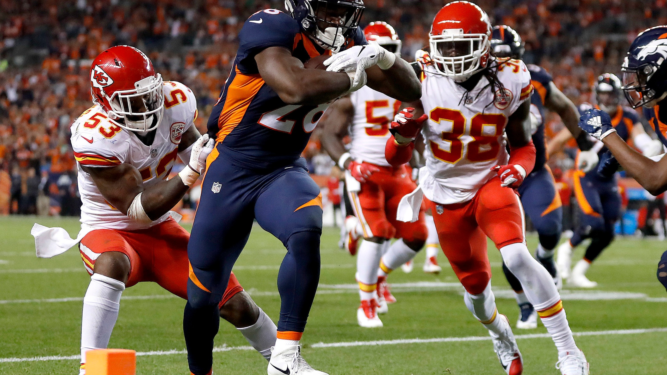 Chiefs linebacker Anthony Hitchens 53 can't stop Broncos running back Royce Freeman 28 from scoring a touchdown as defensive back Ron Parker 38