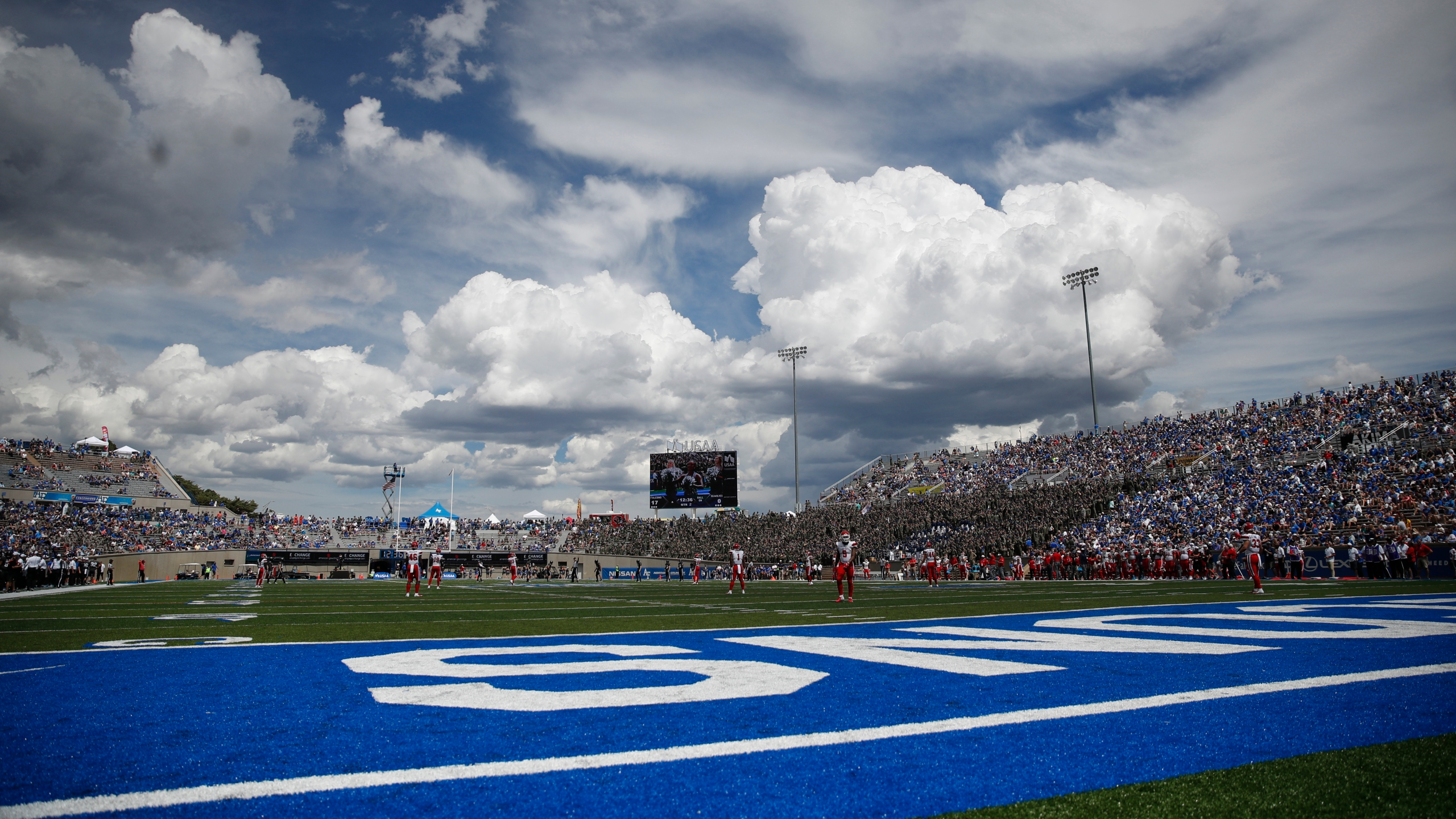 Clouds build over Falcon Stadium as Stony Brook Seawolves face the Air Force Falcons in the first half of an NCAA college football game Saturday, Sept
