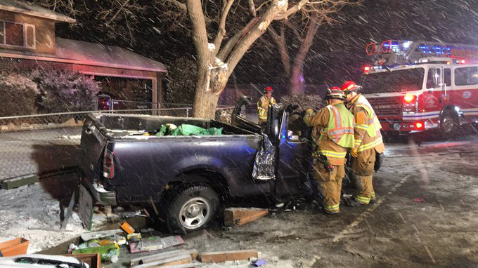 Firefighters extricatea driver after his pickup truck crashed into a tree in southern Colorado Springs Friday evening. Colorado Springs Fire Depart