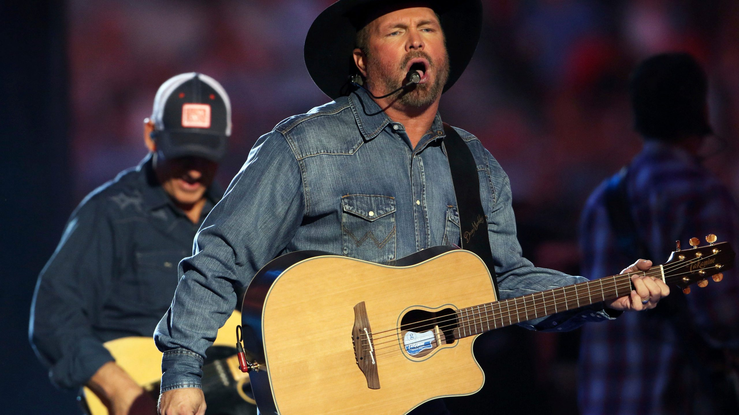 Garth Brooks and musicians perform during the The Garth Brooks World Tour at the Mercedes-Benz Stadium on Thursday, October 12, 2017, in Atlanta. Pho