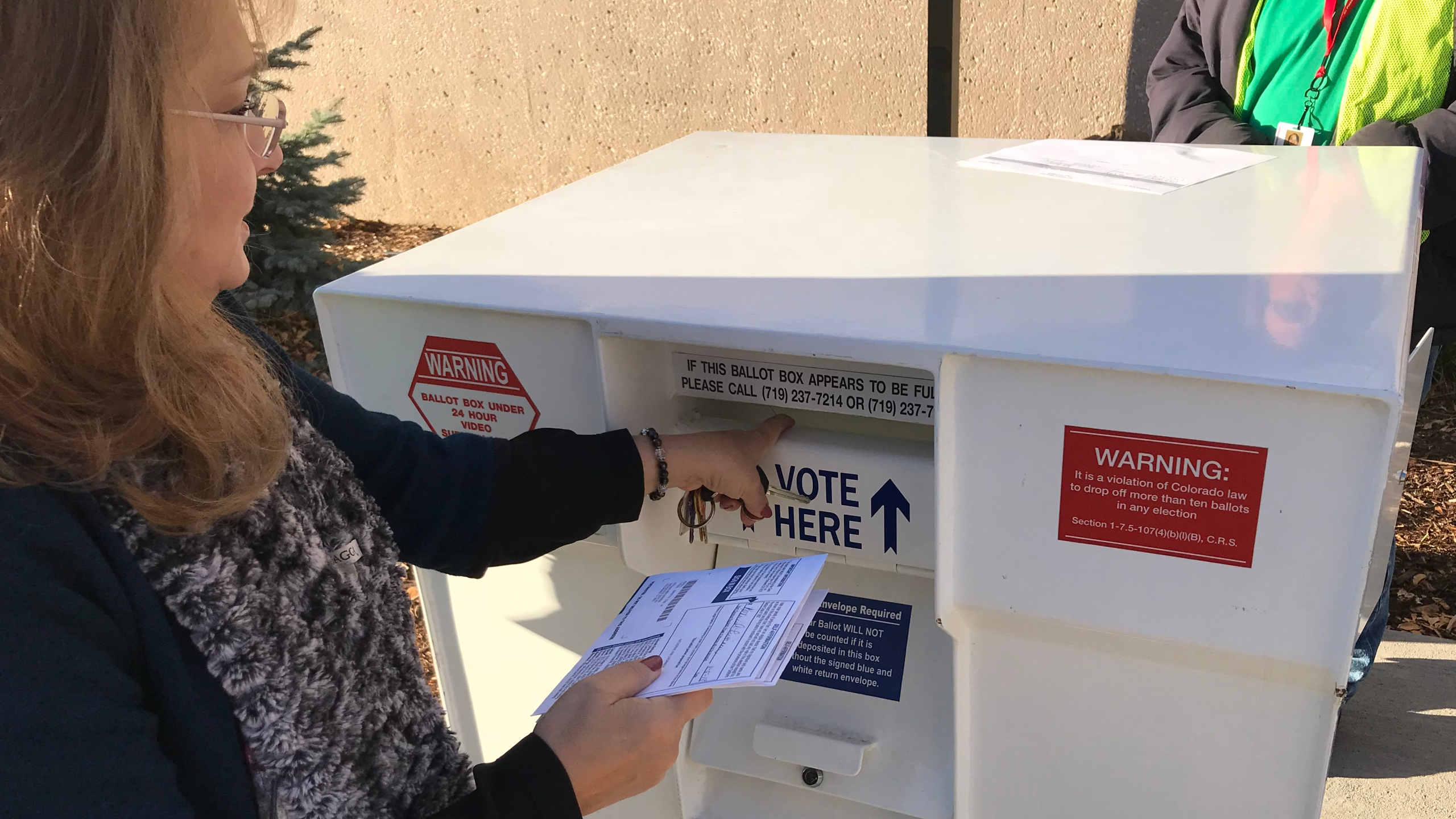 A voter casts her ballot at the El Paso County Clerk's Office branch in downtown Colorado Springs Tuesday morning. Shawn Shanle - FOX21 News