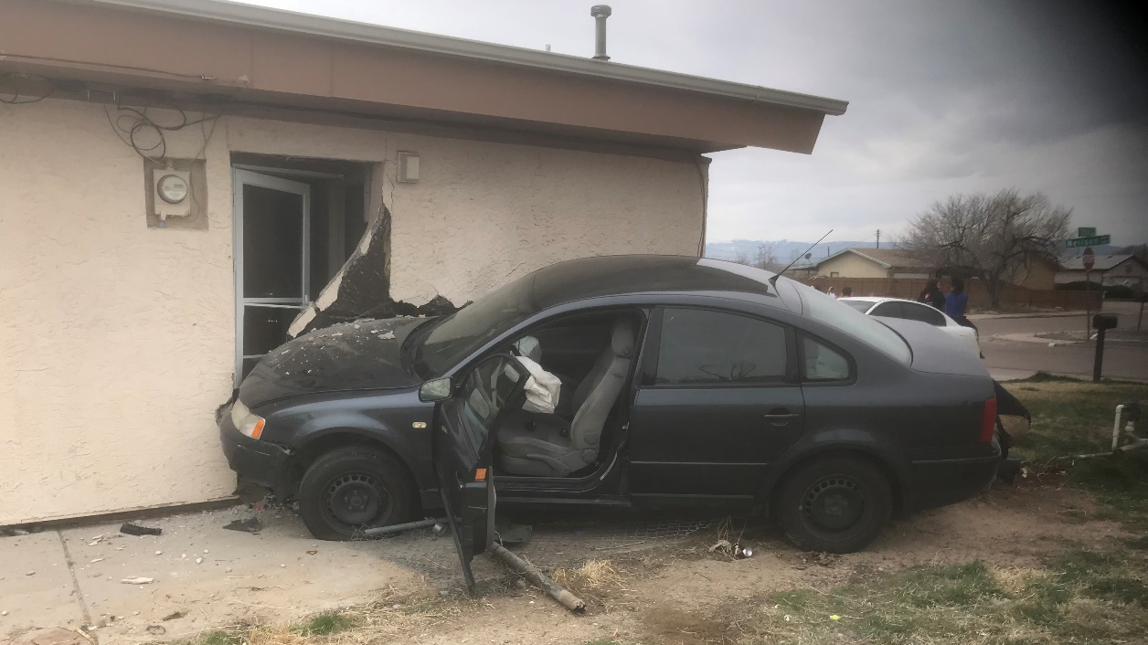 No one was injured when a 13-year-old girl crashed a car into the side of a Pueblo house Friday morning. Photo courtesy Pueblo Police Department