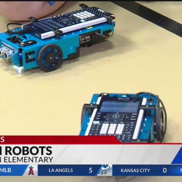 Falcon Elementary students use calculators to program dancing robots