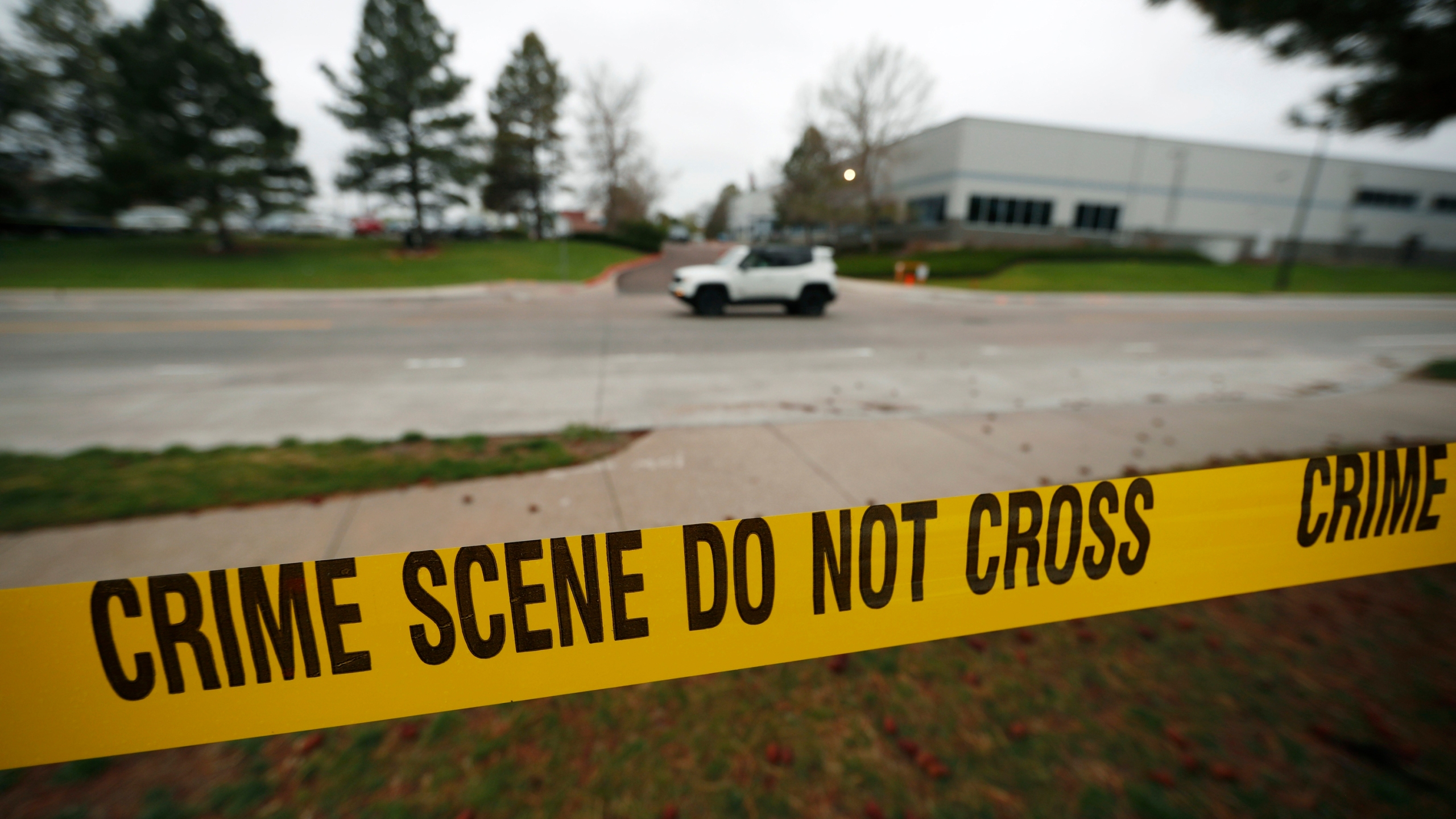 Police tape remains near the scene following Tuesday's shooting at STEM Highlands Ranch school, Wednesday, May 8, 2019, in Highlands Ranch, Colo. AP