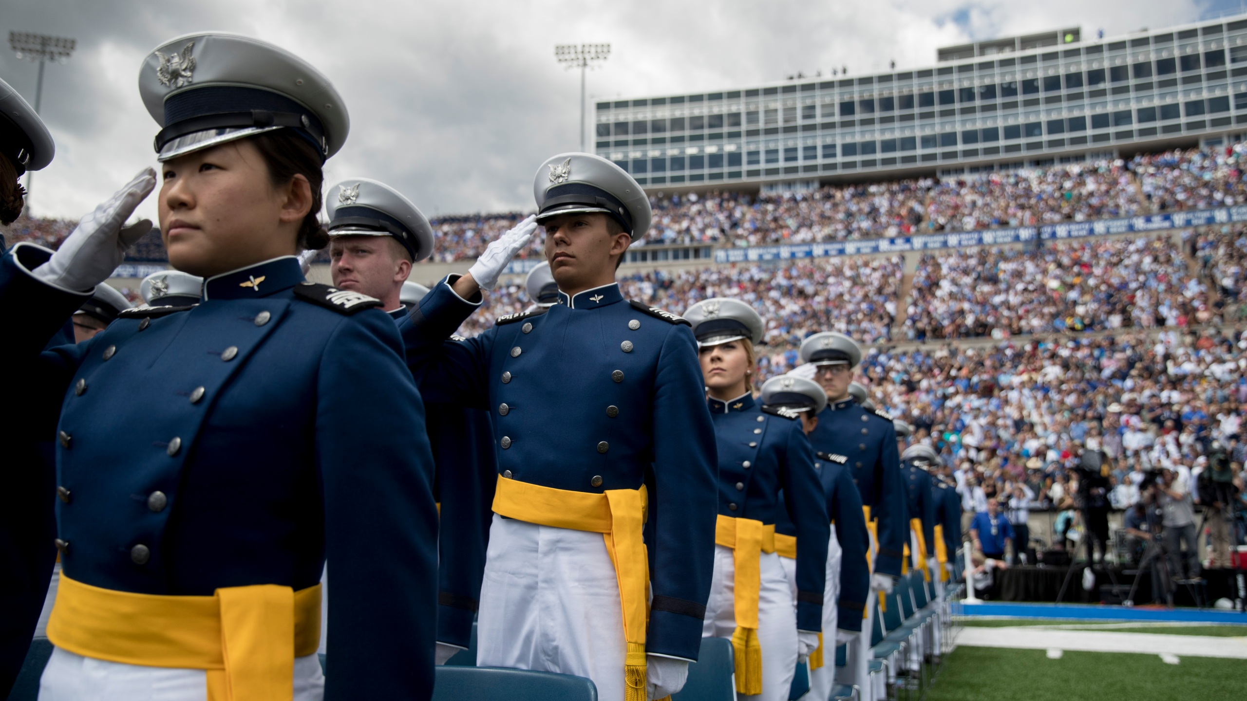 Air Force Cadets salute during the 2019 United States Air Force Academy Graduation Ceremony at Falcon Stadium, Thursday, May 30, 2019, at the United States Air Force Academy, in Colorado Springs, Colo. (AP Photo/Andrew Harnik)
