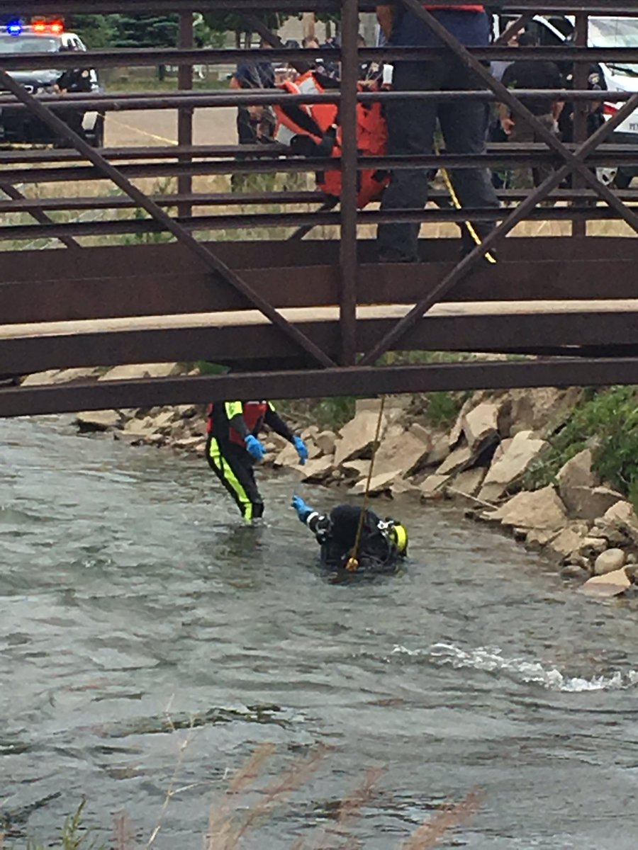 Members of the Pueblo County Sheriff's Office Dive Team recover a man's body from the Bessemer Ditch in eastern Pueblo County Monday. Photo courtesy