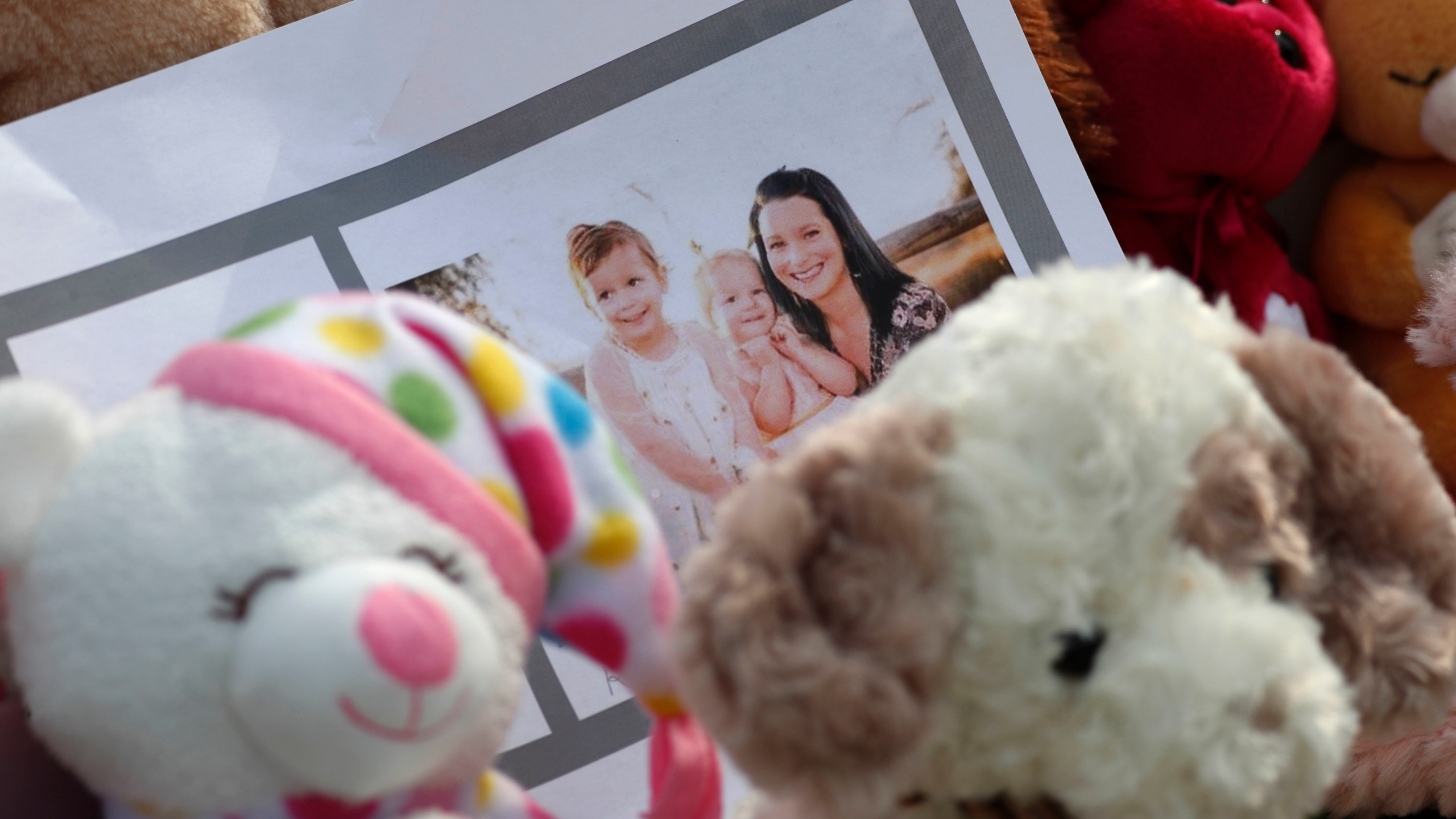 FILE - In this Thursday, Aug. 16, 2018 file photo, a photograph sits amid mementos outside the home where a pregnant woman, Shanann Watts, and her two daughters, Bella and Celeste, lived in Frederick, Colo. (AP Photo/David Zalubowski, File)