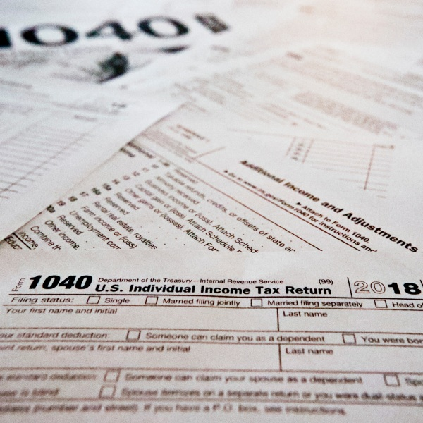 This Wednesday, Feb. 13, 2019, in Zelienople, Pa., shows multiple forms printed from the Internal Revenue Service web page that are used for 2018 U.S. federal tax returns. (AP Photo/Keith Srakocic)