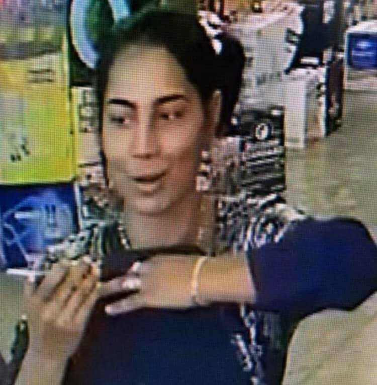 Surveillance image shows the woman accused of stealing cash from a Denver liquor store last week. / Photo courtesy Metro Denver Crime Stoppers via Facebook