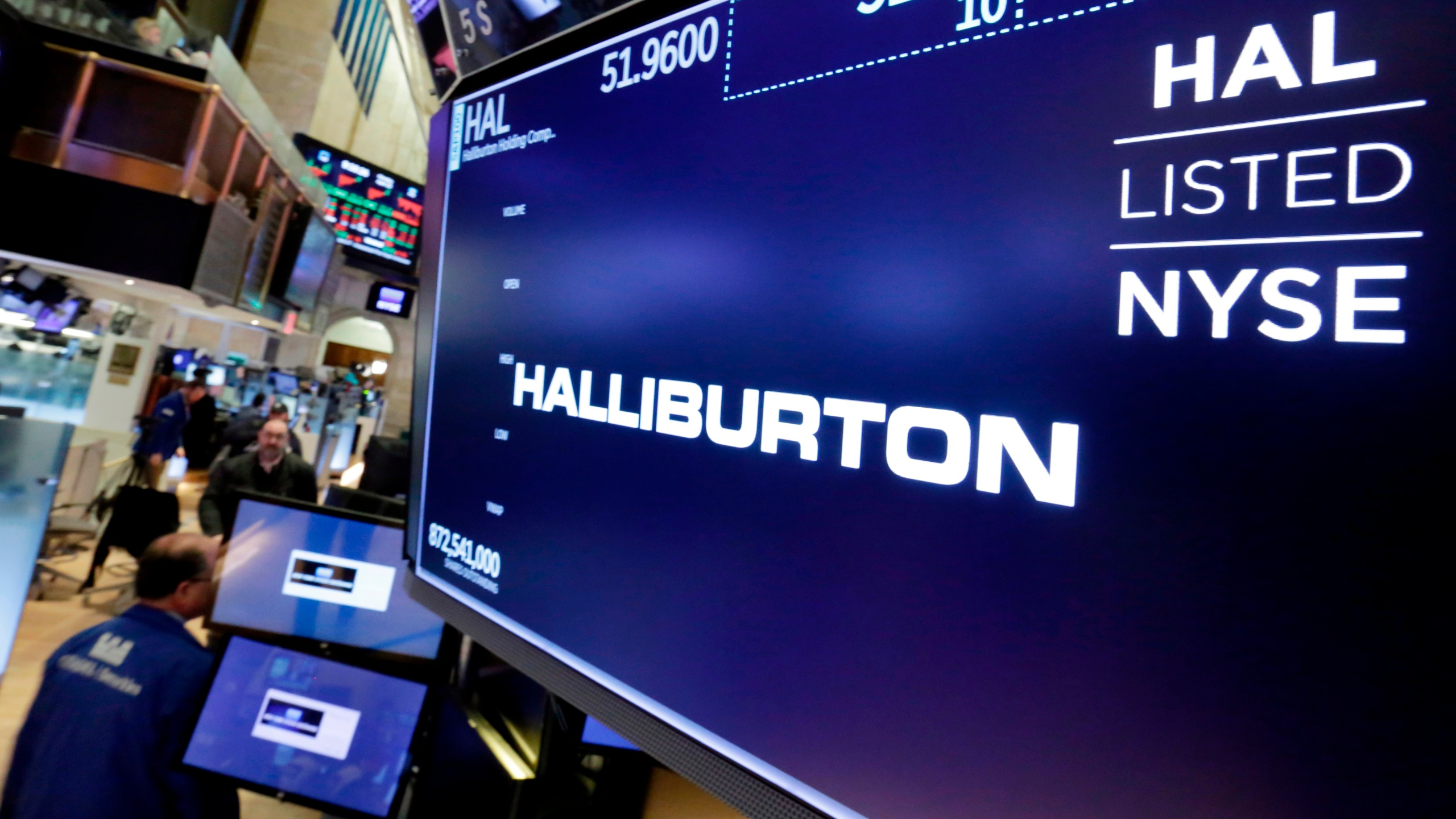 The logo for Halliburton appears above a trading post on the floor of the New York Stock Exchange, Monday, April 23, 2018. (AP Photo/Richard Drew)