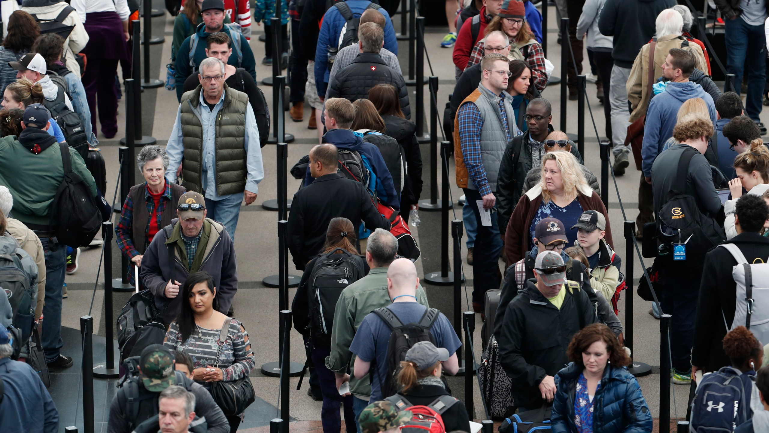 Denver International Airport, security checkpoint, travelers