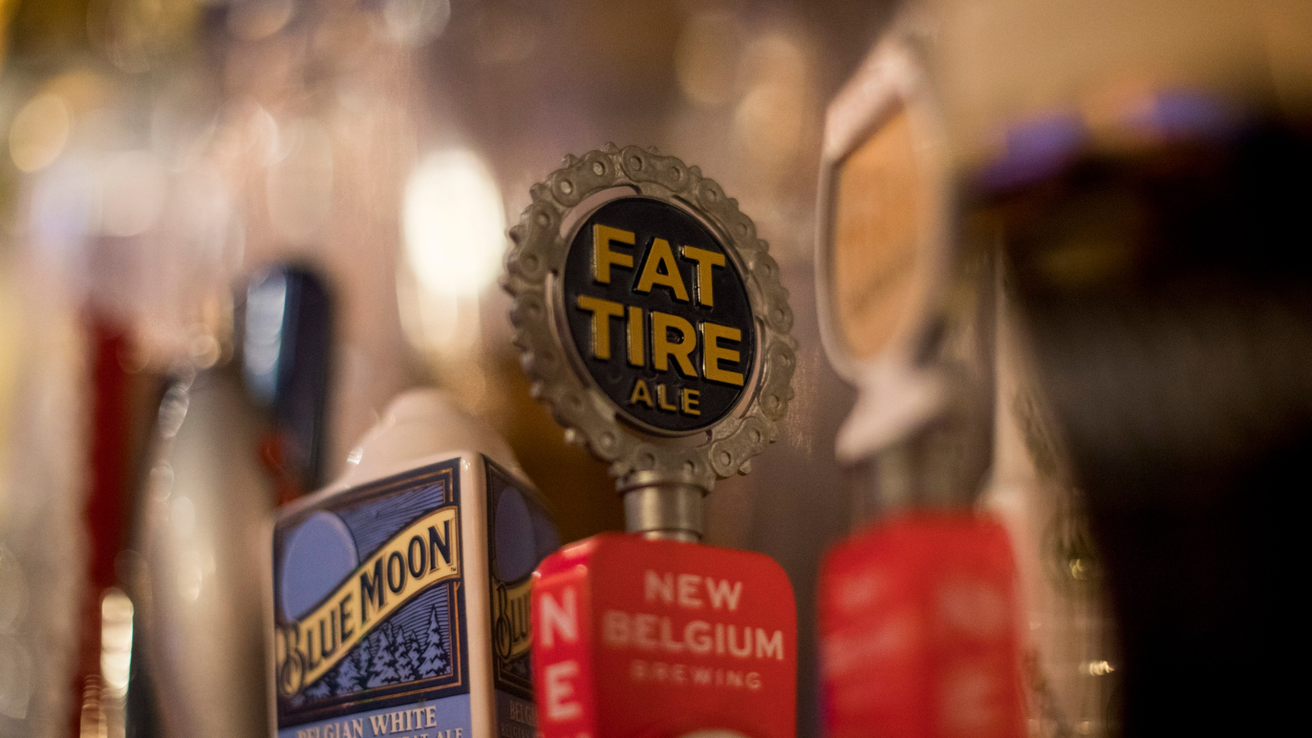 This Dec. 25, 2018, photo shows a Fat Tire tap handle at a bar at the Back Bowl bowling alley in Eagle, Colo. (AP Photo/Jenny Kane)