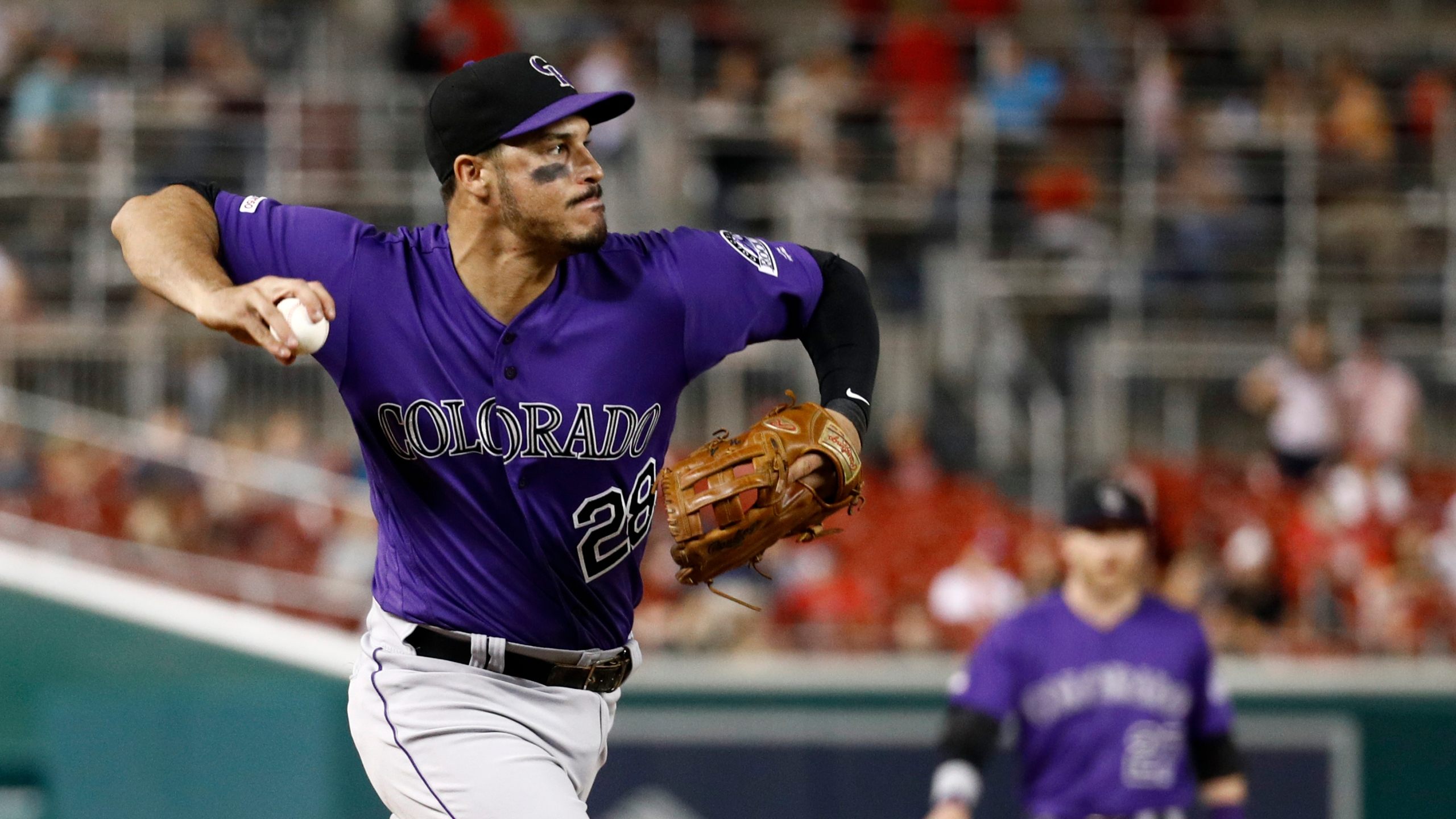 Colorado Rockies third baseman Nolan Arenado throws out Washington Nationals' Brian Dozier at first base in the second inning of the second baseball game of a doubleheader, Wednesday, July 24, 2019, in Washington. (AP Photo/Patrick Semansky)