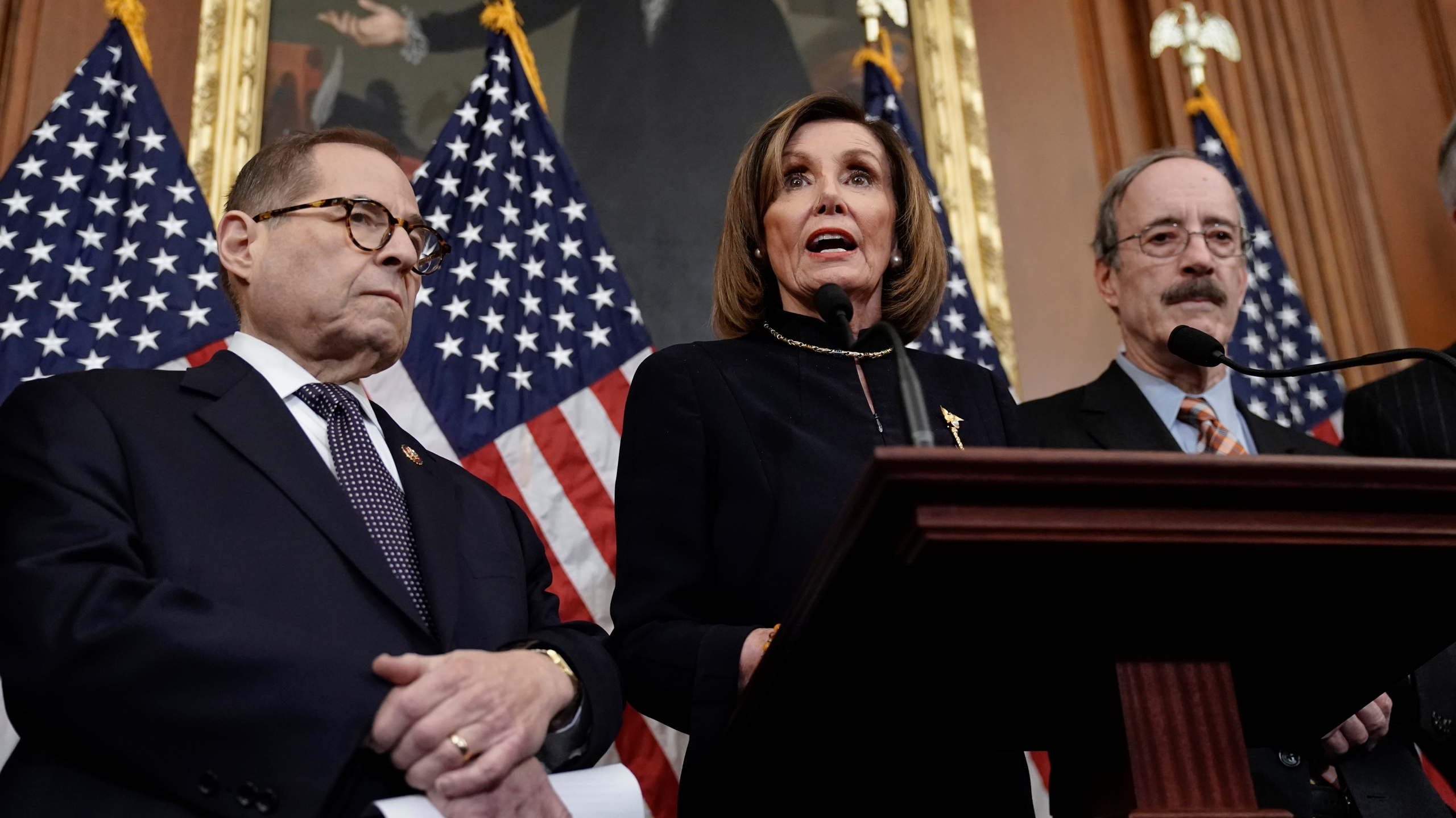 Speaker of the House Nancy Pelosi, D-Calif., flanked by House Judiciary Committee Chairman Jerrold Nadler, D-N.Y., left, and House Foreign Affairs Committee Chairman Eliot Engel, D-N.Y., speaks reporters at the Capitol in Washington, Wednesday, Dec. 18, 2019, after the House of Representatives voted to impeach President Donald Trump. (AP Photo/J. Scott Applewhite)