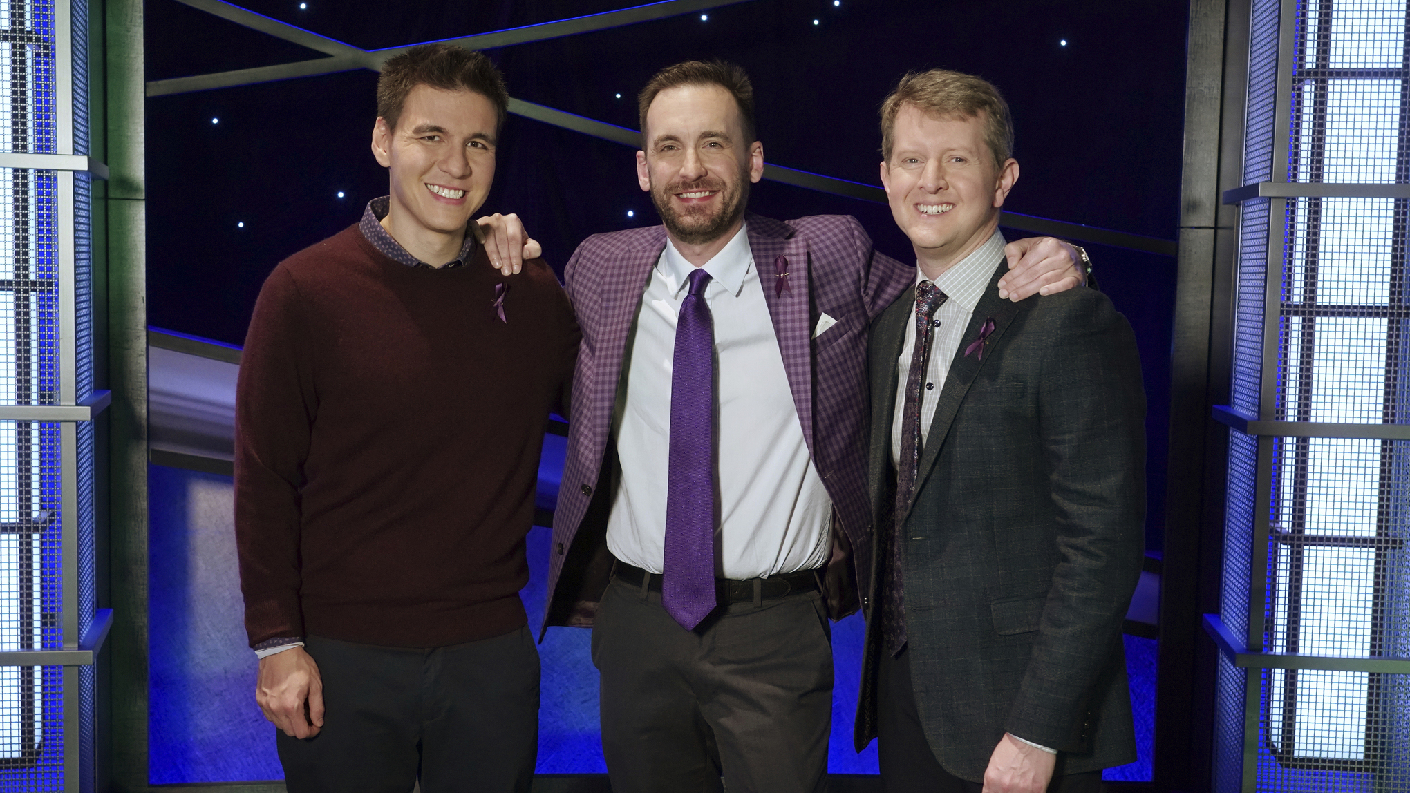 "In this image released by ABC, contestants, from left, James Holzhauer, Brad Rutter and Ken Jennings appear on the set of ""Jeopardy!"" in Los Angeles (Eric McCandless/ABC via AP)"
