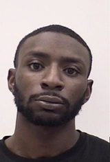 TIMOTHY JAUAN BARRON is a Black Male, 25 years old, 6' tall, and 180 lbs., with black hair and brown eyes. BARRON is wanted for Assault, False Imprisonment and Harassment.