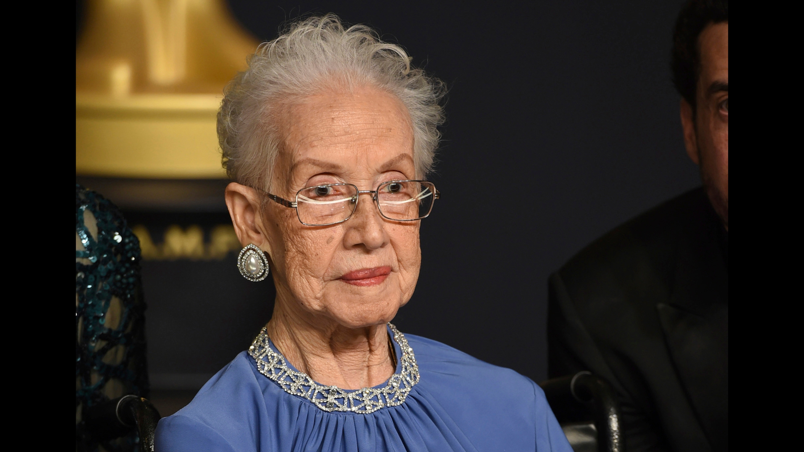 """FILE - In this Feb. 26, 2017, file photo, Katherine Johnson, the inspiration for the film, """"Hidden Figures,"""" poses in the press room at the Oscars at the Dolby Theatre in Los Angeles. (Photo by Jordan Strauss/Invision/AP, File)"""
