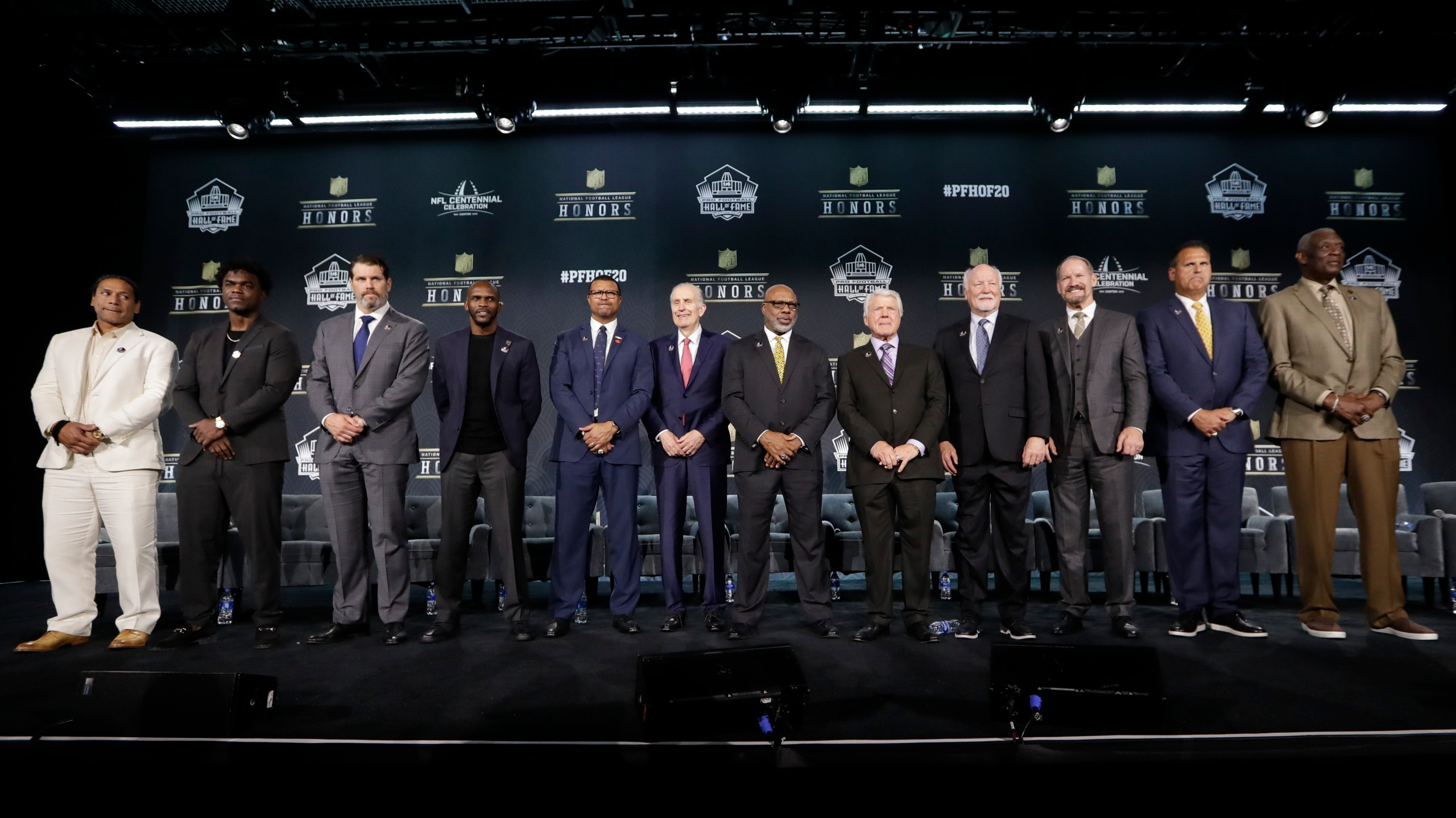 Hall of Fame Class of 2020, from left, Troy Polamalu, Edgerrin James, Steve Hutchinson, Isaac Bruce, Steve Atwater, Paul Tagliabue, Donnie Shell, Jimmie Johnson, Cliff Harris, Bill Cowher, Jimbo Covert, and Harold Carmichael pose at the NFL Honors football award show Saturday, Feb. 1, 2020, in Miami. (AP Photo/Mark Humphrey)