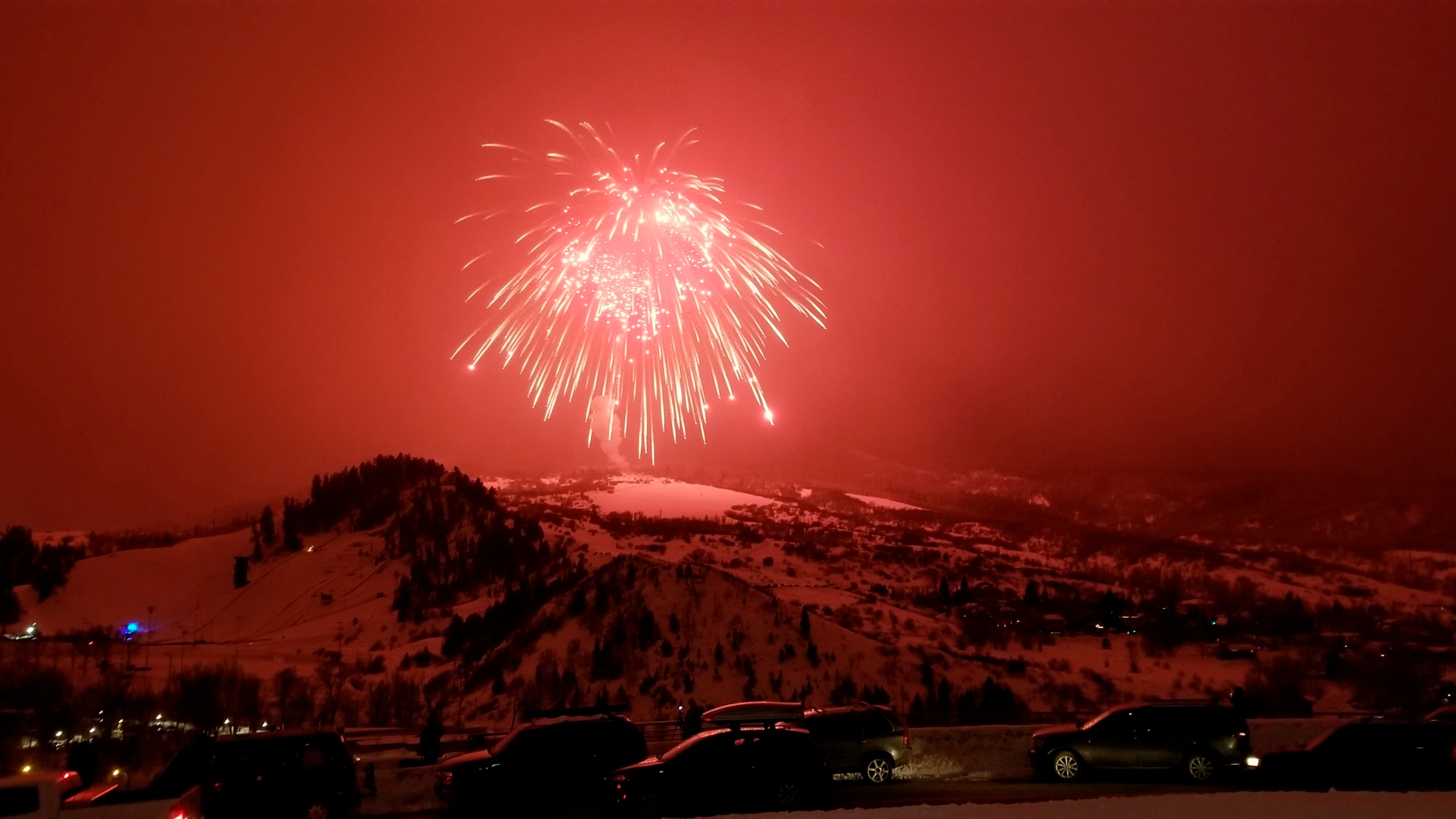 In this Saturday, Feb. 8, 2020 photo, a firework launched over Colorado ski resort town of Steamboat Springs explodes Saturday, Feb. 8, 2020. (AP Photo/Steve Caulk)