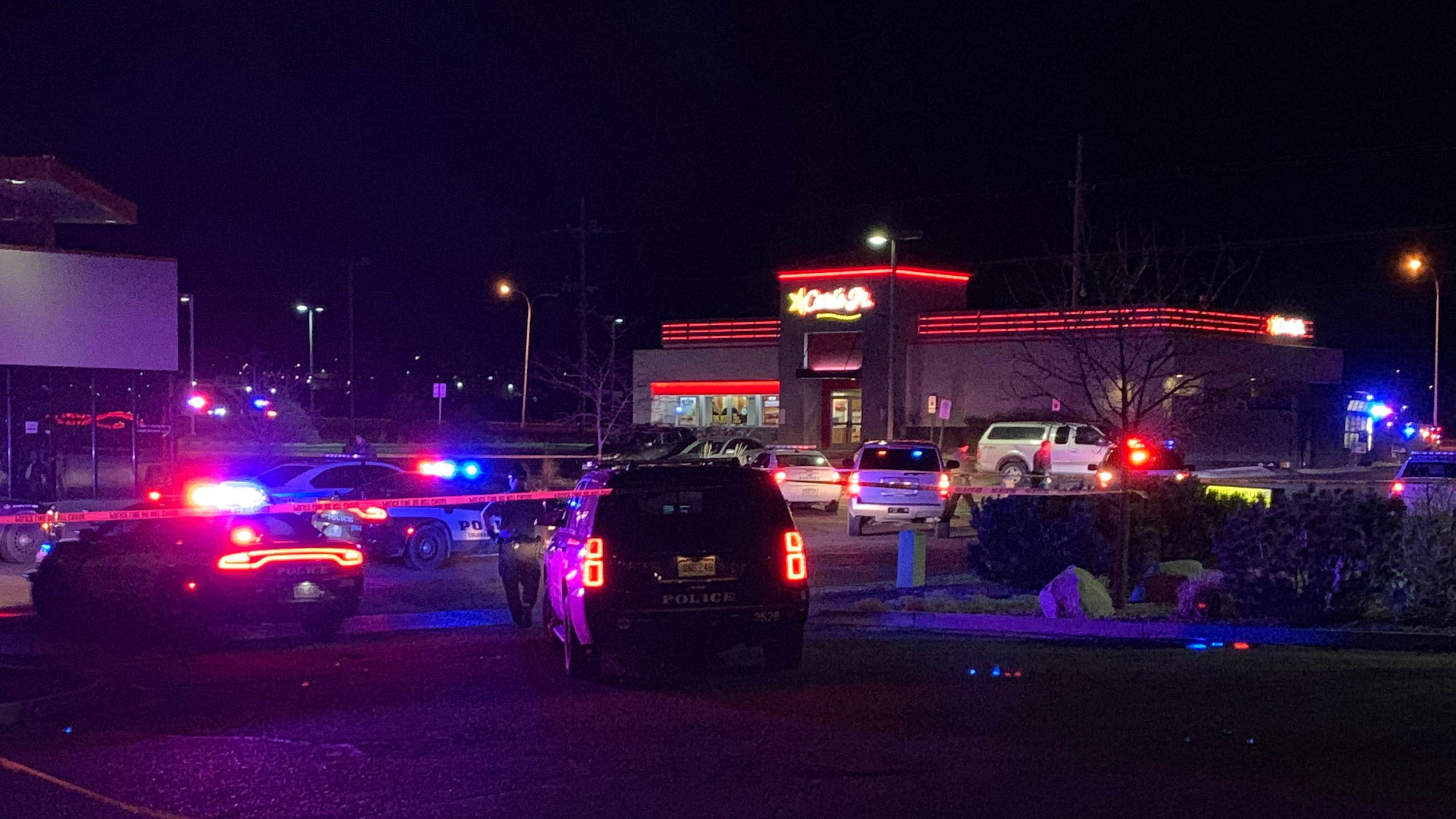 Law enforcement officers investigate a shooting in the drive-thru of the Carl's Jr. at Powers Boulevard and Galley Road Thursday morning. / Craig Denton Jr. - FOX21 News