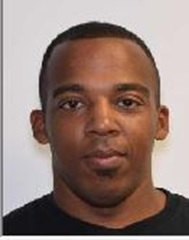 """MICHAEL DUNWAN TAYLOR is a Black Male, 33 years old, 5'9"""" tall, and 209 lbs., with black hair and brown eyes. TATLOR is wanted for First Degree Assault."""