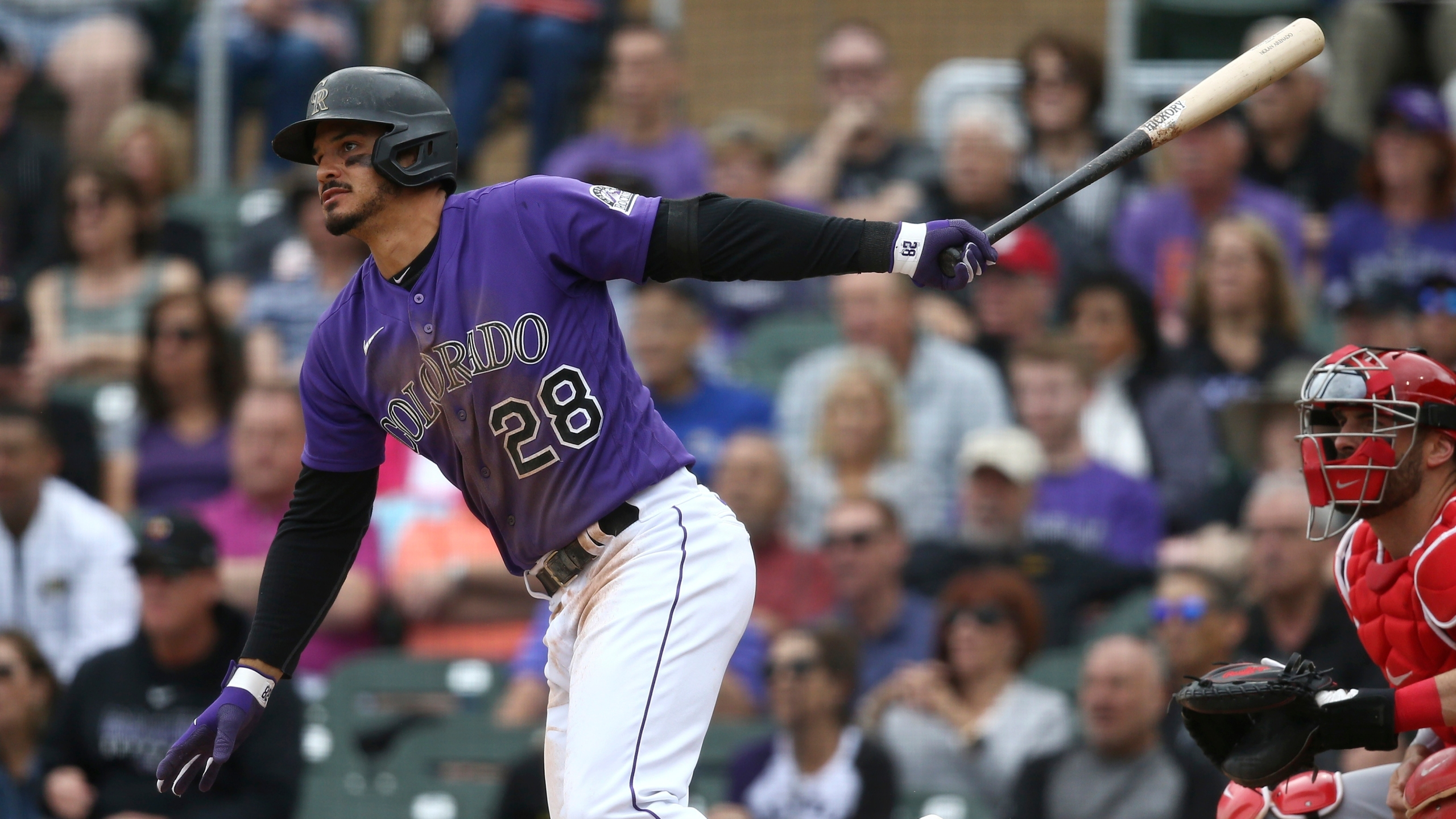 Colorado Rockies' Nolan Arenado follows through on a swing during the third inning of a spring training baseball game against the Cincinnati Reds Tuesday, March 10, 2020, in Scottsdale, Ariz. (AP Photo/Ross D. Franklin)