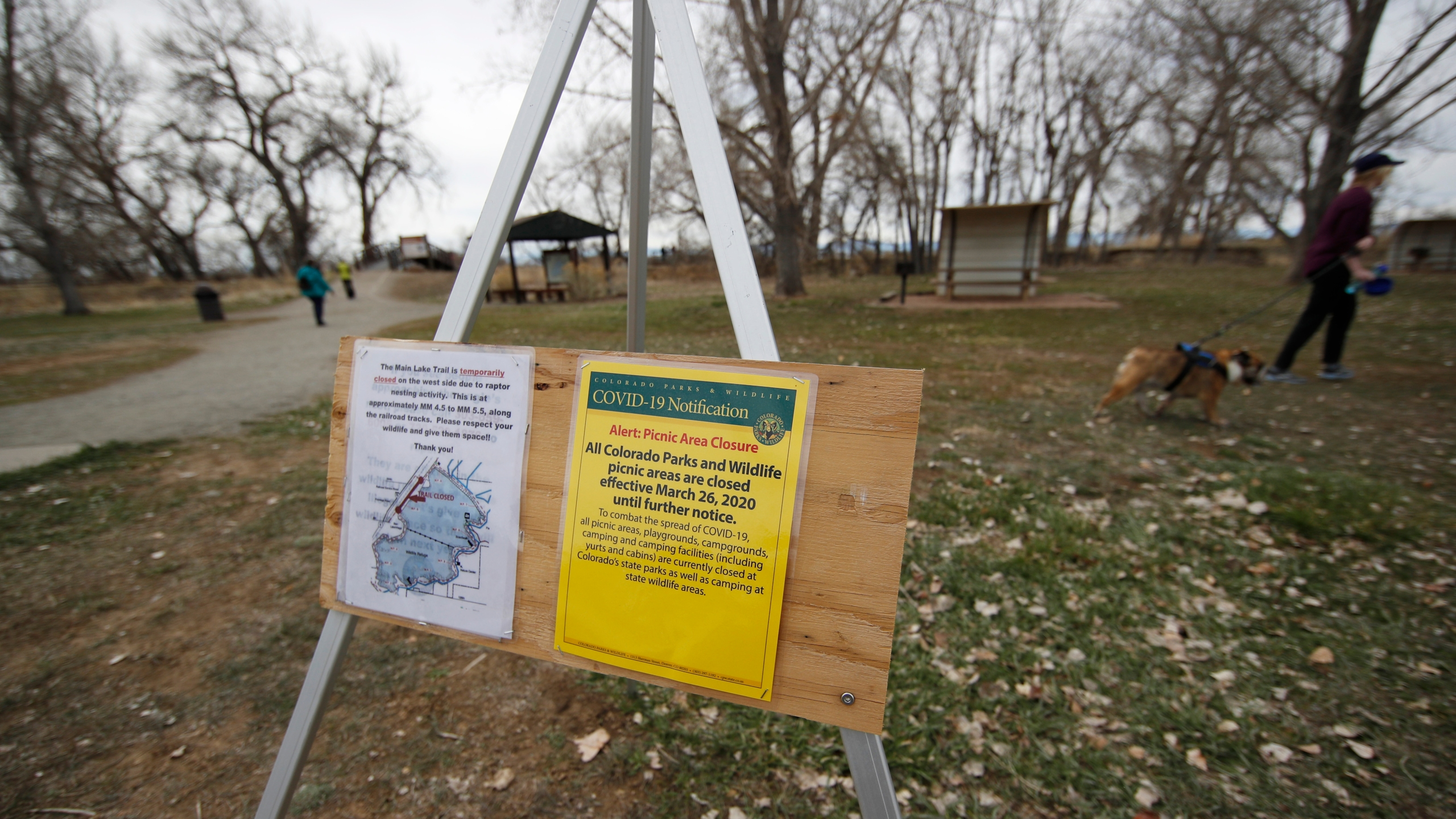 A sign puts visitors on notice that picnic areas are closed at Barr Lake State Park as a statewide stay-at-home order remains in effect in an effort to reduce the spread of the new coronavirus Sunday, March 29, 2020, in Brighton, Colo. (AP Photo/David Zalubowski)