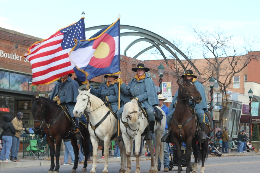 Members of the Fort Carson Mounted Color Guard lead the Colorado Springs Veterans Day Parade along Tejon Street Saturday downtown Nov.3. (Photo by Staff Sgt. Chris Perkey / 1st Stryker Brigade Combat Team, 4th Infantry Division Public Affairs)