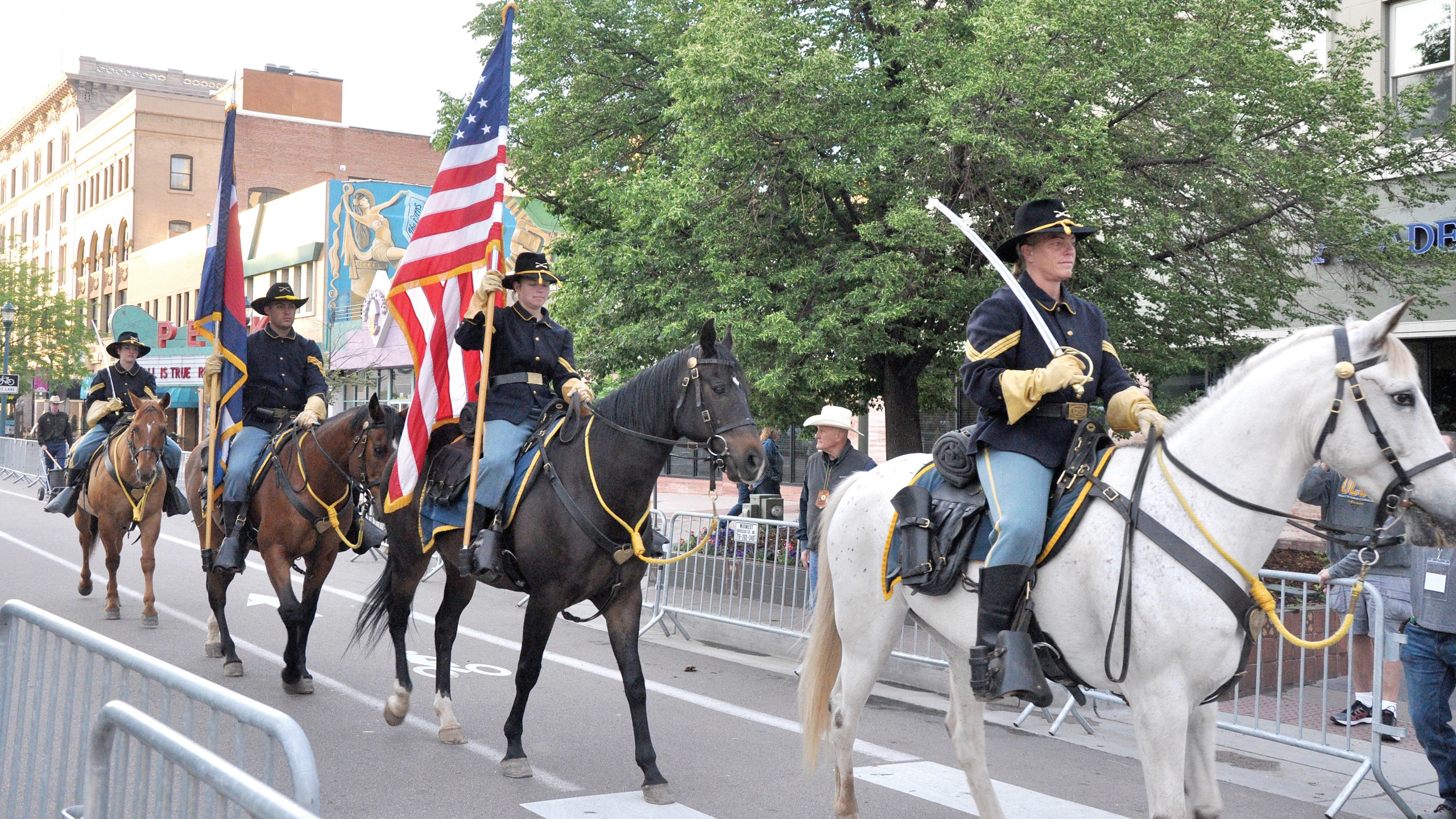 The 4th Infantry Division and Fort Carson Mounted Color Guard present the colors June 19, 2019, at the Western Street Breakfast in downtown Colorado Springs. (Photo by Norman Shifflett/Fort Carson Public Affairs Office)