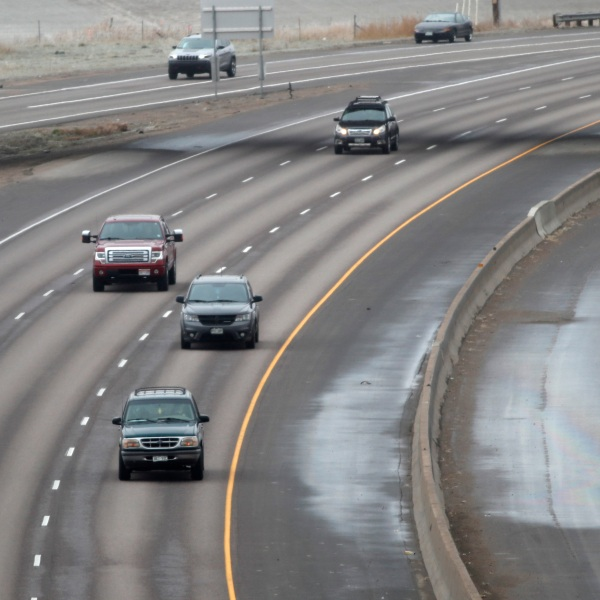 Light traffic floews southbound along Interstate 25 as a statewide stay-at-home order remains in effect in an effort to reduce the spread of the new coronavirus Thursday, April 2, 2020, in Thornton, Colo.(AP Photo/David Zalubowski)