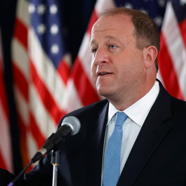Colorado Governor Jared Polis makes a point during a news conference to update the state's efforts to stop the rise of the new coronavirus Wednesday, May 20, 2020, in Denver. (AP Photo/David Zalubowski)