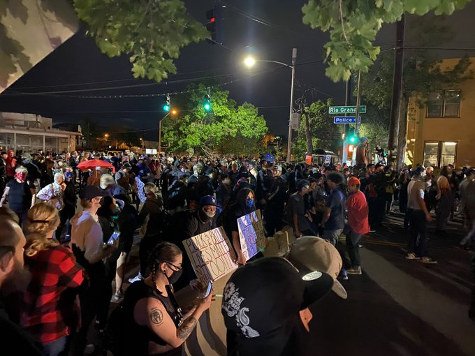 Protesters outside of the Police Operations Center around 9:30 p.m. Sunday night. / Brandon Thompson - FOX21 News