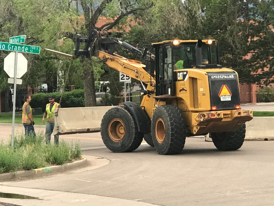 City crews place a barricade outside the Police Operations Center in downtown Colorado Springs Sunday afternoon. / Shawn Shanle - FOX21 News