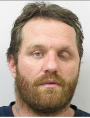 DUSTIN THOMAS WASBERG is a White Male, 46 years old, 6' tall, and 200 lbs., with brown hair and blue eyes. WASBERG is wanted for Assault, False Imprisonment and Harassment.