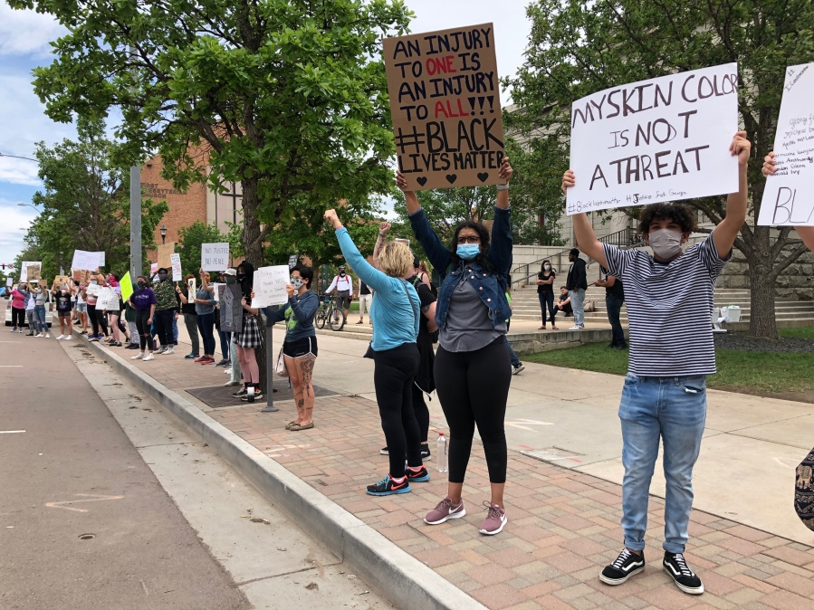 Protesters in front of City Hall in downtown Colorado Springs Tuesday afternoon. / Mike Duran - FOX21 News