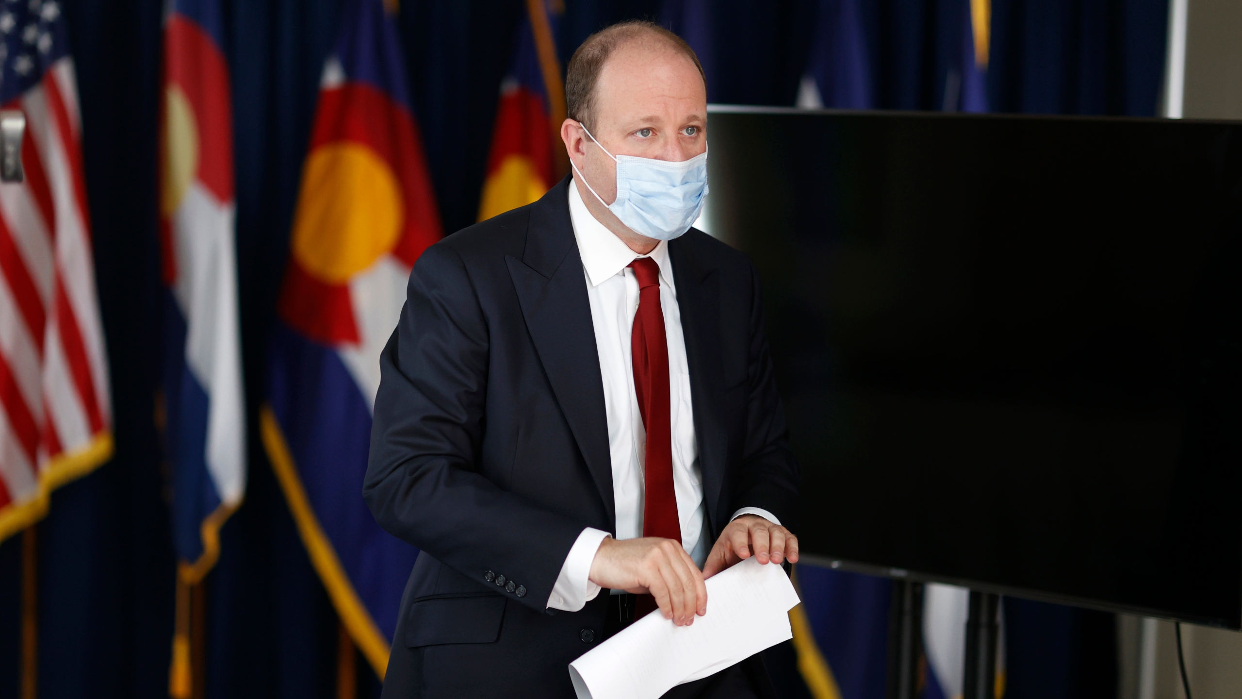 Colorado Governor Jared Polis heads out of a news conference on the state's efforts to deal with the effects of the new coronavirus Tuesday, June 9, 2020, in Denver. (AP Photo/David Zalubowski)