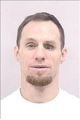 """JASON ROBERT FLYNN is a White Male, 43 years old, 6'4"""" tall, and 200 lbs., with brown hair and blue eyes. FLYNN is wanted for Child Abuse, Burglary, Menacing, Trespassing, Possession of a Weapon by an Offender and Prohibited Use of a Weapon."""